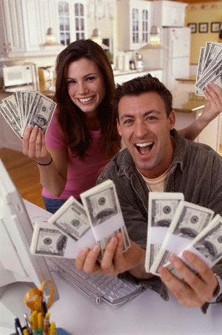 Happy couple with dollar notes
